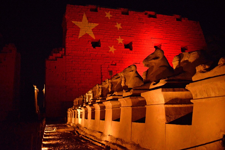 The Karnak Temple in Luxor, Egypt is pictured on 1 March 2020 with the Chinese flag projected on it in solidarity with the Chinese people amid the Covid-19 pandemic. (AFP)