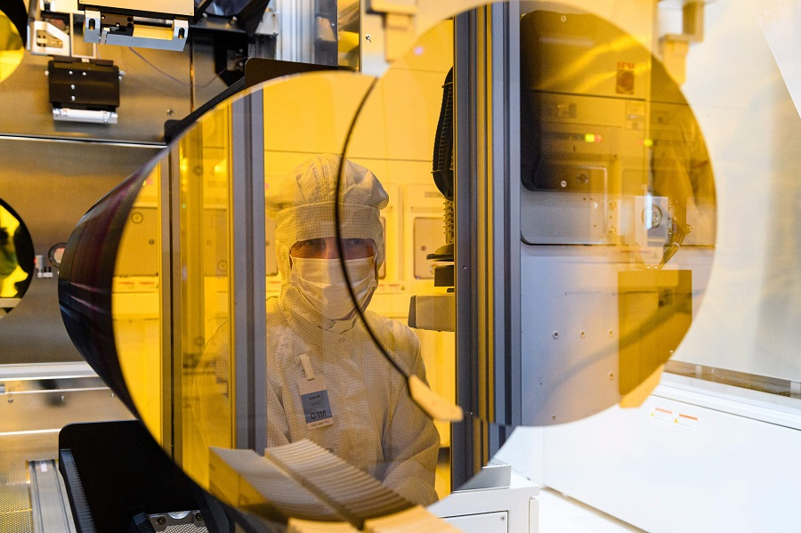 This file photo taken on 31 May 2021 shows an employee of the semiconductor manufacturer Bosch working in a clean room during the preparations for the series production of semiconductor chips on innovative 300-millimetre wafers in Dresden, Germany. (Jens Schlueter/AFP)