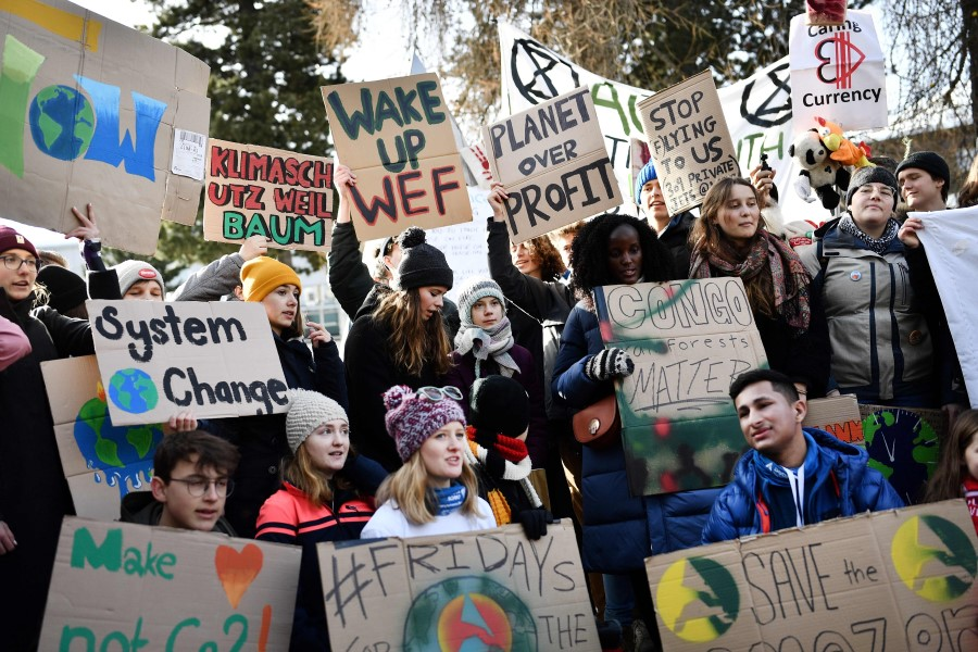 In this file photo taken on 24 January 2020, climate activists including Greta Thunberg (centre) march in a street of Davos on the sideline of the World Economic Forum (WEF) annual meeting. (Fabrice Coffrini/AFP)