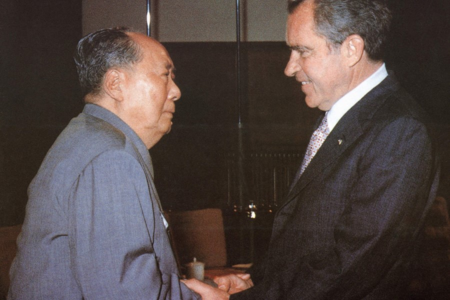 In this file photo former Chinese communist leader Chairman Mao Zedong (L) welcomes former US President Richard Nixon at his house in the Forbidden City in Beijing on 22 February 1972. (Handout/AFP)