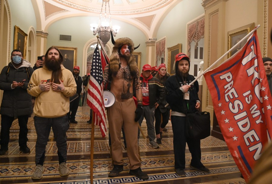 In this file photo from 6 January 2021, supporters of US President Donald Trump enter the US Capitol, in Washington, DC. (Saul Loeb/AFP)