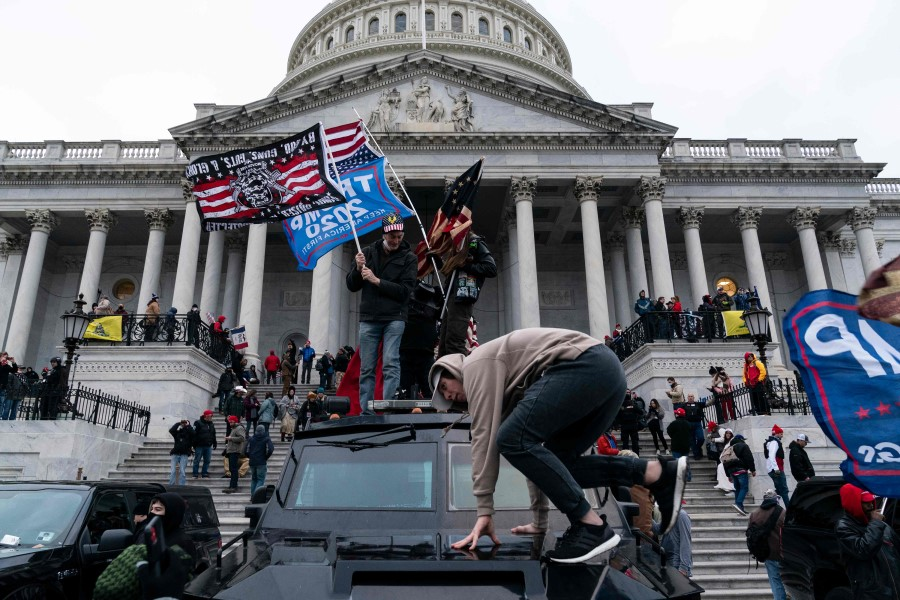 In this file photo taken on 6 January 2021 Supporters of US President Donald Trump protest outside the US Capitol in Washington, DC. (Alex Edelman/AFP)