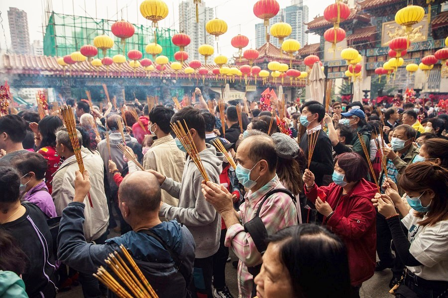 Seeking spirituality is a universal human need. In this photo taken on 25 January 2020, people wearing face masks visit Wong Tai Sin temple on the first day of the Lunar New Year of the Rat in Hong Kong, as a preventative measure against the Covid-19 coronavirus. (Dale De La Rey/AFP)