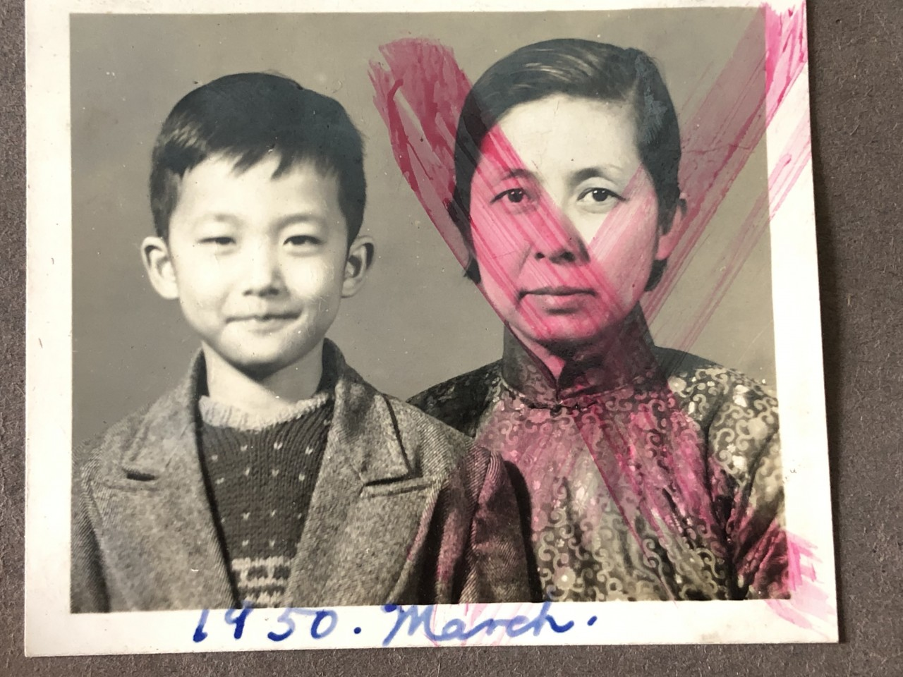 Teo Soon Kim (right) with only son Peter Wang, taken in March 1950. The photo was vandalised during the Cultural Revolution.