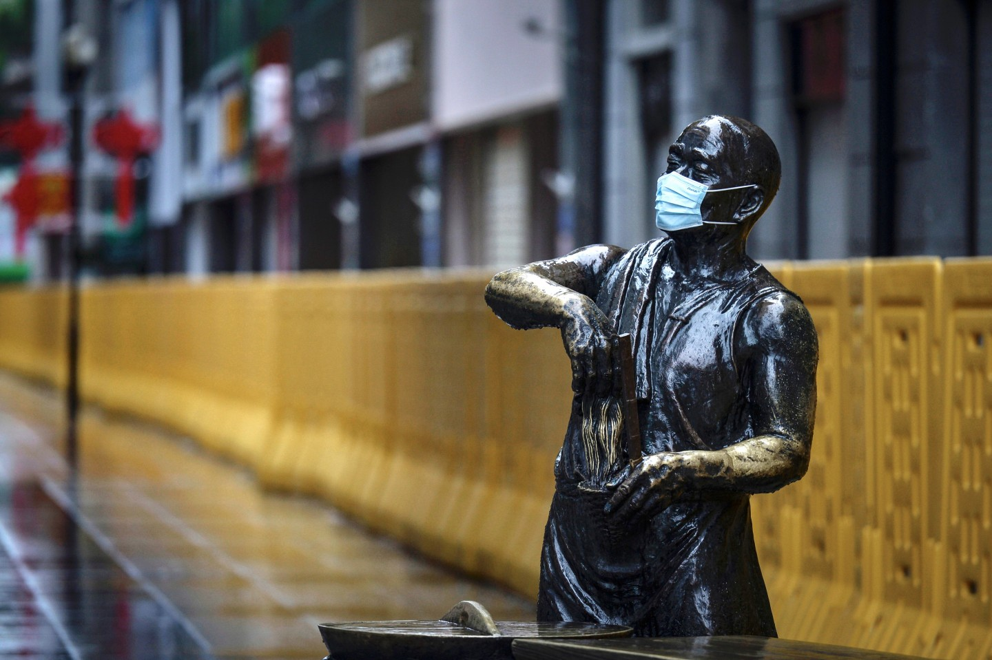 This photo taken on 28 February 2020 shows a statue with a face mask on in Wuhan. (STR/AFP)