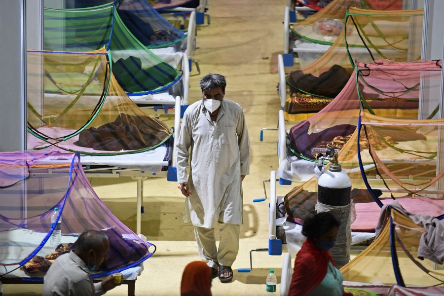 Patients who have tested positive for Covid-19 are seen inside a centre of the Commonwealth Games (CWG) village which has been temporarily converted into a Covid care facility in New Delhi on 2 May 2021. (Tauseef Mustafa/AFP)