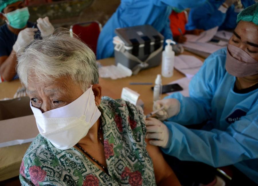 A woman receives the Sinovac Covid-19 coronavirus vaccine in Denpasar, Indonesia's Bali island on 2 September 2021. (Sonny Tumbelaka/AFP)