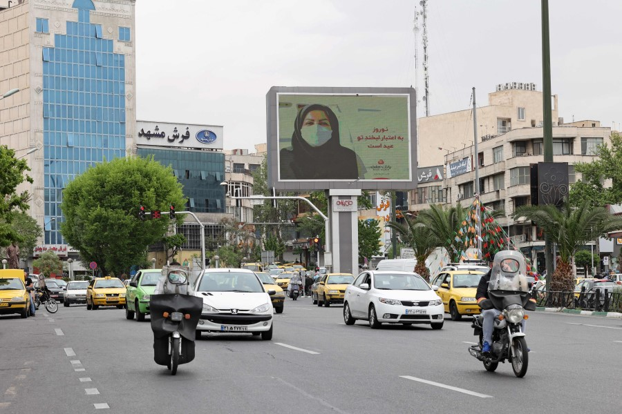 Iranians drive down a street in the capital Tehran, on 11 April 2021. (Atta Kenare/AFP)