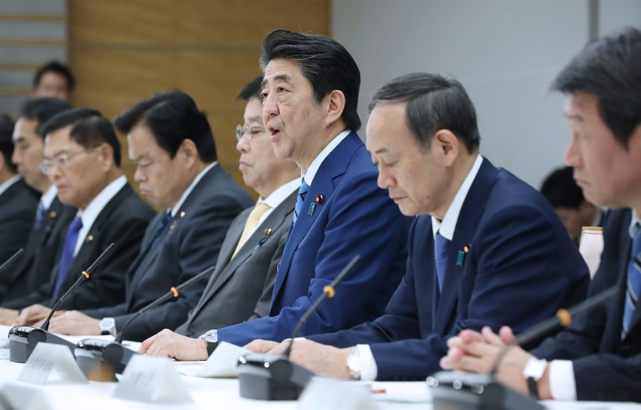 Japan's Prime Minister Shinzō Abe (C) speaks during a meeting at the new COVID-19 coronavirus infectious disease control headquarters at the prime minister's office in Tokyo on February 27, 2020. ( Jiji Press/AFP)