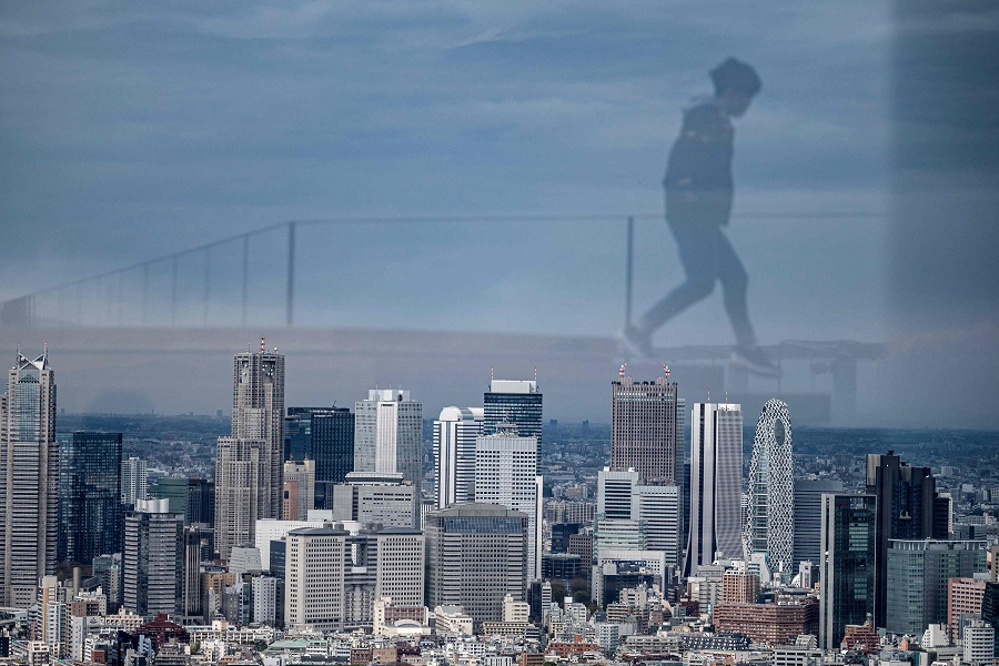 A general view shows the skyline of Tokyo's Shinjuku area on 22 March 2021. (Charly Triballeau/AFP)