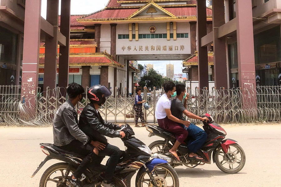 Motorists pass the China-Myanmar border gate in Muse in Shan state on 5 July 2021. (STR/AFP)