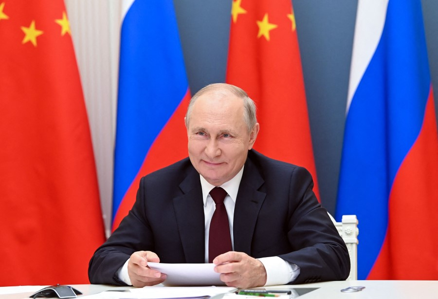 Russian President Vladimir Putin holds a meeting via video conference with Chinese President Xi Jinping (not seen) at the Kremlin in Moscow on 28 June 2021. (Alexey Nikolsky/Sputnik/AFP)