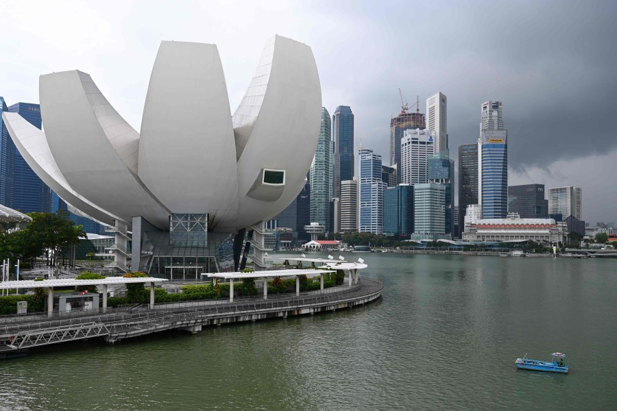A general view shows the ArtScience Museum (left) against the backdrop of the city skyline in Singapore on 28 January 2021. (Roslan Rahman/AFP)