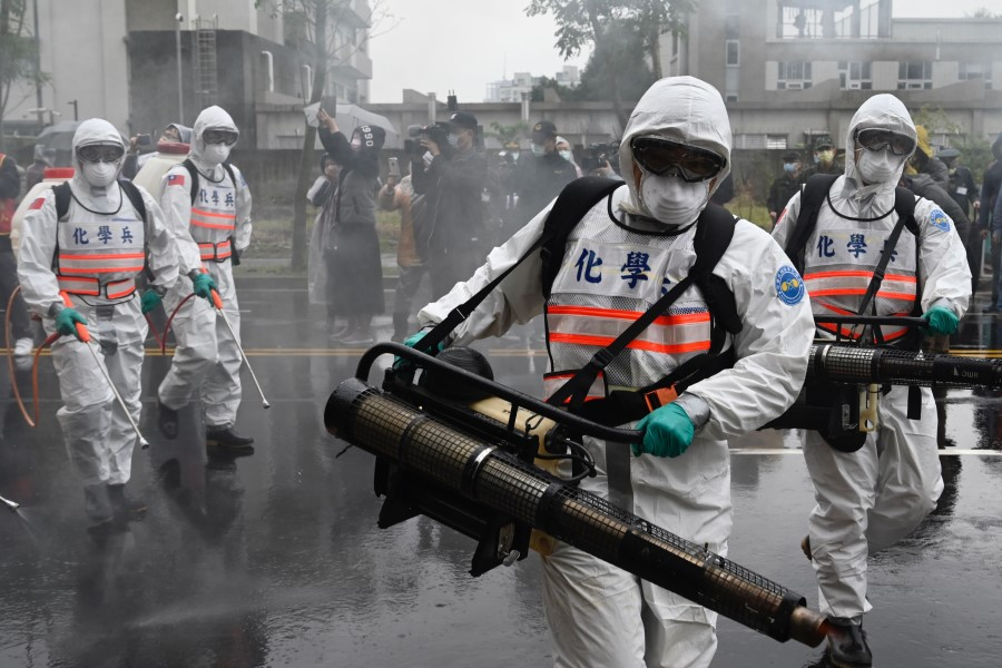 Soldiers from the military's chemical units take part in a drill organised by the New Taipei City government to prevent the spread of the Covid-19 coronavirus, in Xindian district on March 14, 2020. Over 450 medical staff, community volunteers, government employees and military personnel took part in the drill. Taiwan has won praise for its handling of the epidemic. (Sam Yeh/AFP)