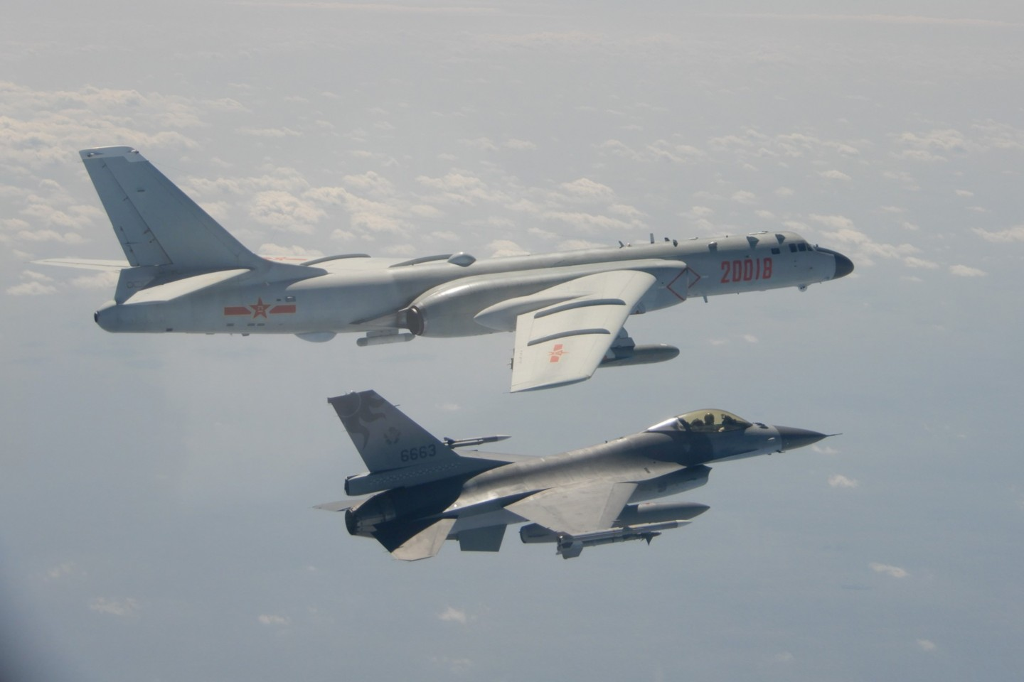 This handout photo taken and released on 10 February 2020 by Taiwan's Defense Ministry shows a Taiwanese F-16 fighter jet flying next to a Chinese H-6 bomber (top) in Taiwan's airspace. (Handout/Taiwan's Defense Ministry/AFP)