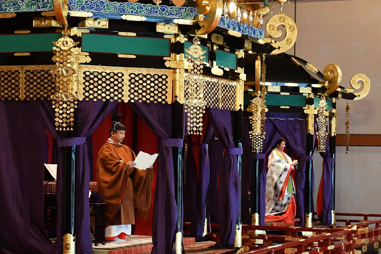 Emperor Naruhito (left) and Empress Masako (right) attend the enthronement ceremony where the emperor officially proclaims his ascension to the Chrysanthemum Throne at the Imperial Palace in Tokyo on October 22, 2019. (Kazuhiro Nogi/POOL/AFP)