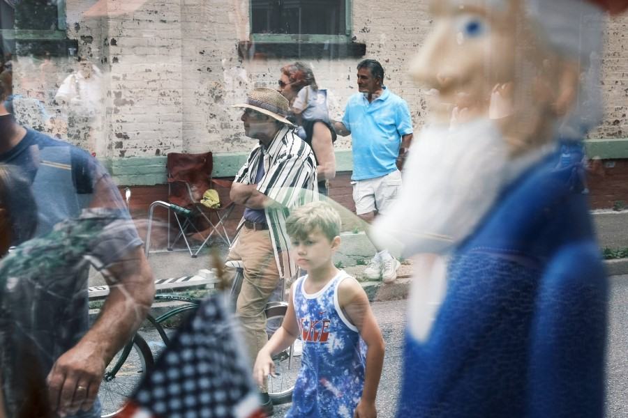 People watch the annual Fourth of July parade on 4 July 2021 in Saugerties, New York. (Spencer Platt/Getty Images/AFP)