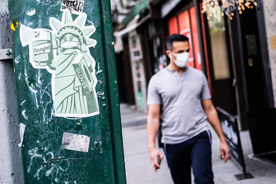 A sticker of the Statue of Liberty wearing a mask is seen on 10 May 2020 in the Manhattan borough of New York City. (Jeenah Moon/Getty Images/AFP)