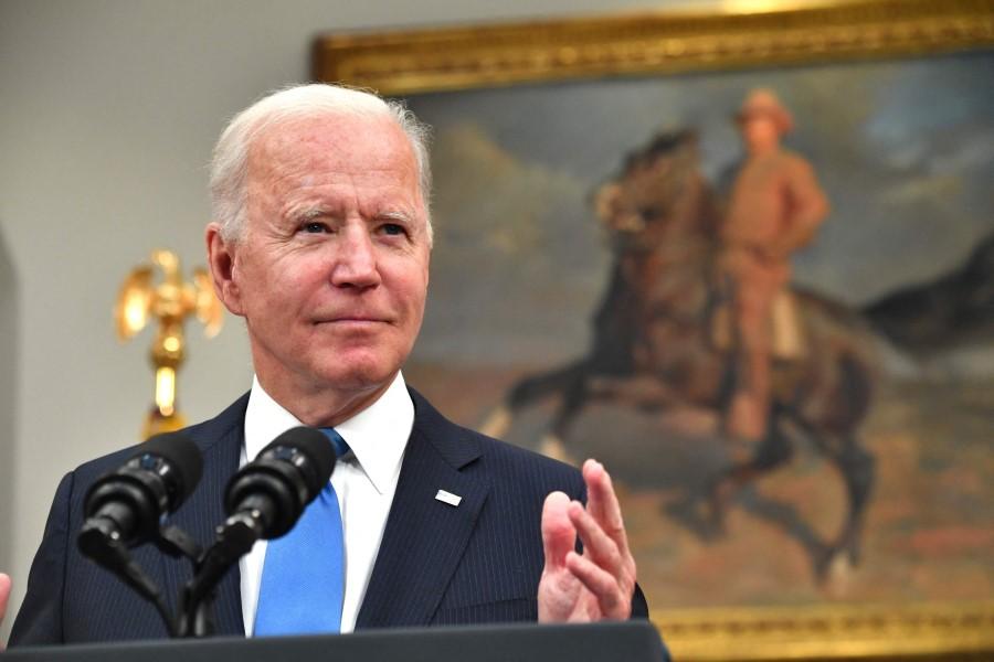 US President Joe Biden speaks in the Roosevelt Room of the White House in Washington, DC on 13 May 2021. (Nicholas Kamm/AFP)