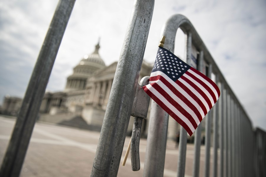 An American flag is placed on a fence outside of the US Capitol building on 28 September 2020 in Washington, DC. (Al Drago/AFP)