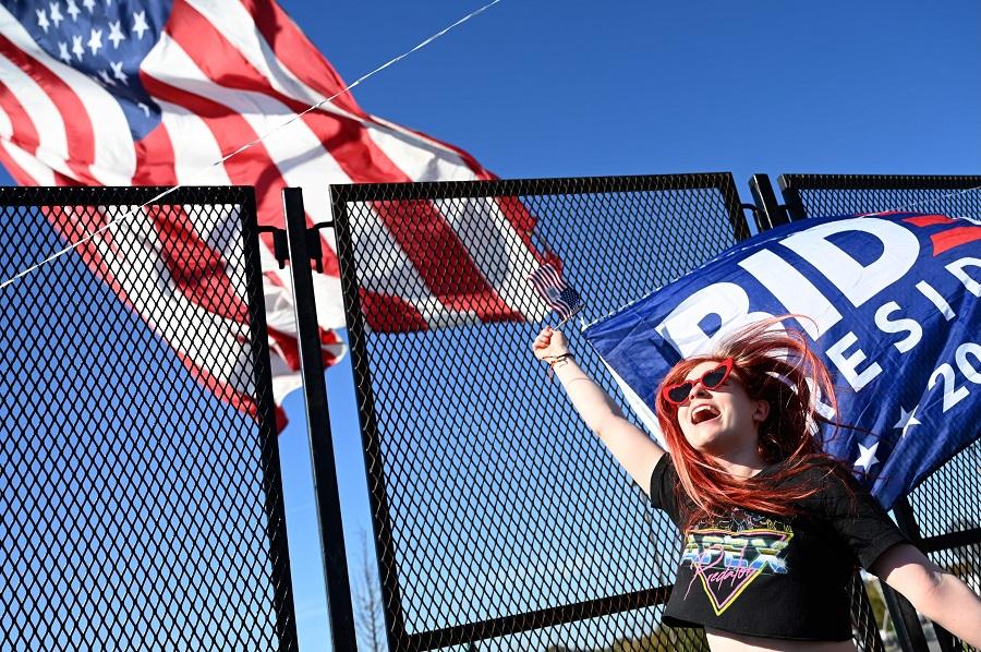 A supporter of President-elect Joe Biden celebrate his victory in Wilmington, Delaware on 7 November 2020. (Jim Watson/AFP)