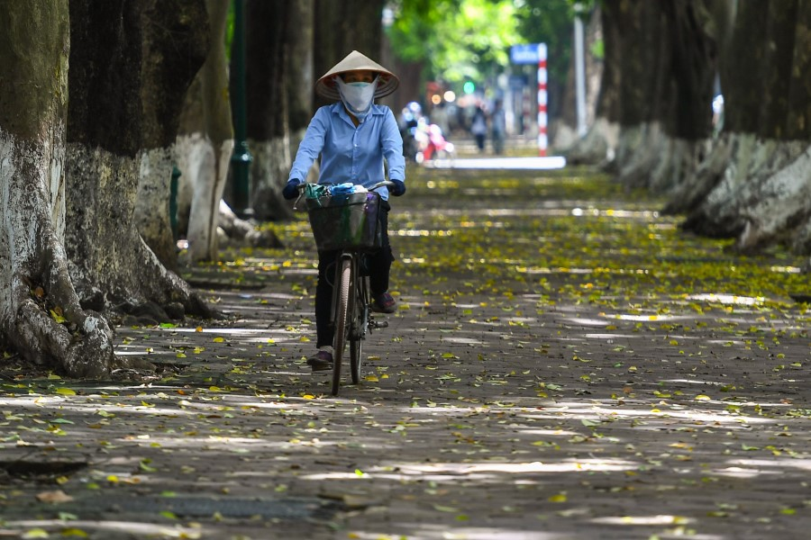 A woman cycles in Hanoi on 21 September 2020. (Nhac Nguyen/AFP)