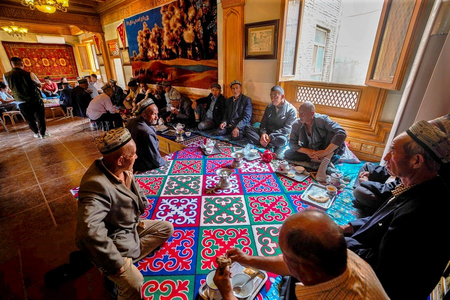 "Is Xinjiang becoming a new ""Palestinian issue""? In this photo taken on 17 May 2020, residents are having tea in a teahouse in Kashgar, Xinjiang, China. (Xinhua)"