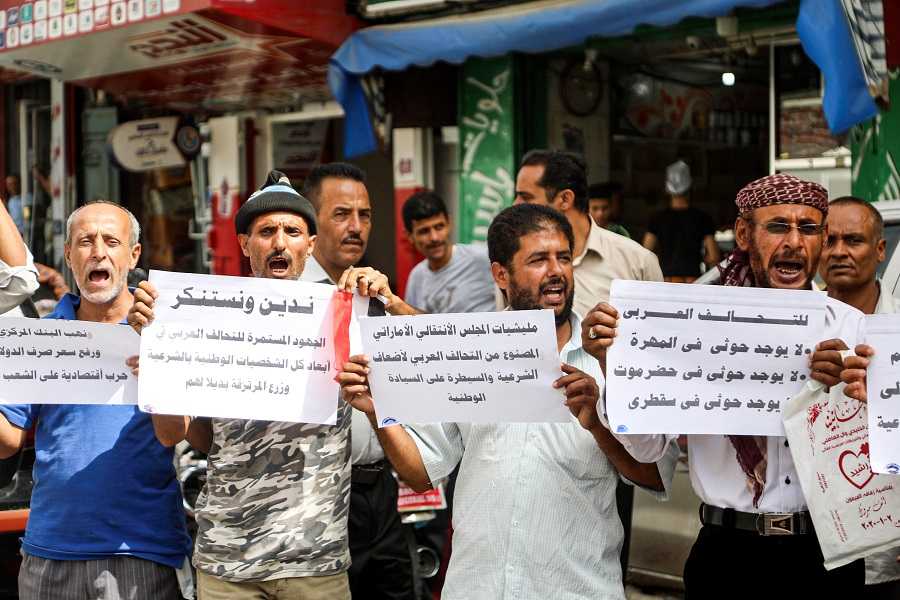 Yemenis protest against the United Arab Emirates and the Southern Transitional Council (STC) in the country's city of Taez on 24 June 2020, after the STC's southern separatists seized control of the strategic island of Socotra. (Ahmad Al-Basha/AFP)