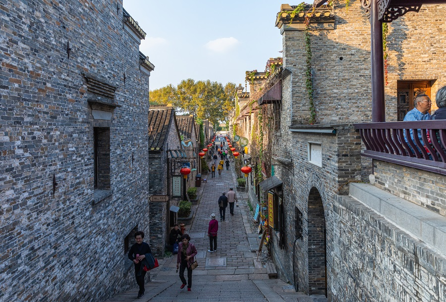 People walk along an alley in Zhenjiang Xijin Ferry site, said to be the birthplace of Zhenjiang ham jelly. (iStock)