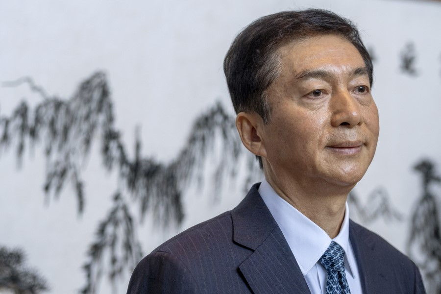 Luo Huining is taking over as the director of mainland China's liaison office in Hong Kong. Will there be a change in Hong Kong politics? (Justin Chin/Bloomberg)