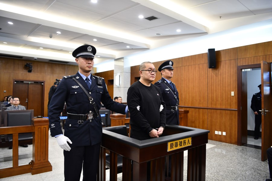 Crime boss Sun Xiaoguo in court. Sun was sentenced to death for multiple crimes, from rape to organised crime. (Xinhua)
