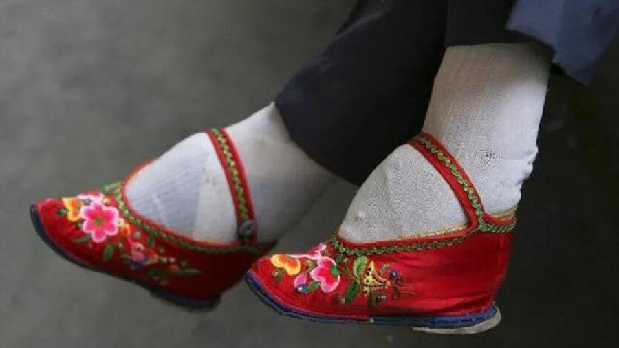 Foot binding was required for women to be in contact with as few men as possible and remain a virgin. (Internet)