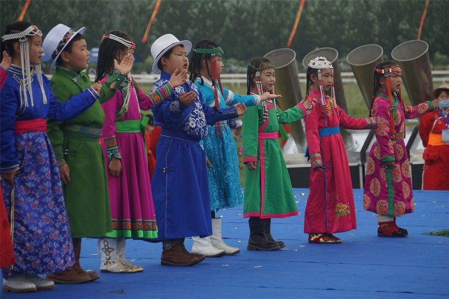 Children in traditional costumes sing and perform at the opening ceremony of the Naadam festival in Hinggan League, Inner Mongolia, 8 August 2020. (CNS)