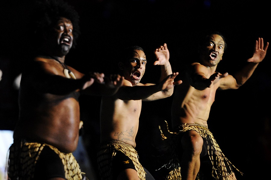 Dancers perform the Maori Haka of New Zealand to represent the city of Auckland, New Zealand, during the Flame Arrival Celebrations at the National University of Singapore, 6 August 2010. (Joseph Nair/SPH-SYOGC)