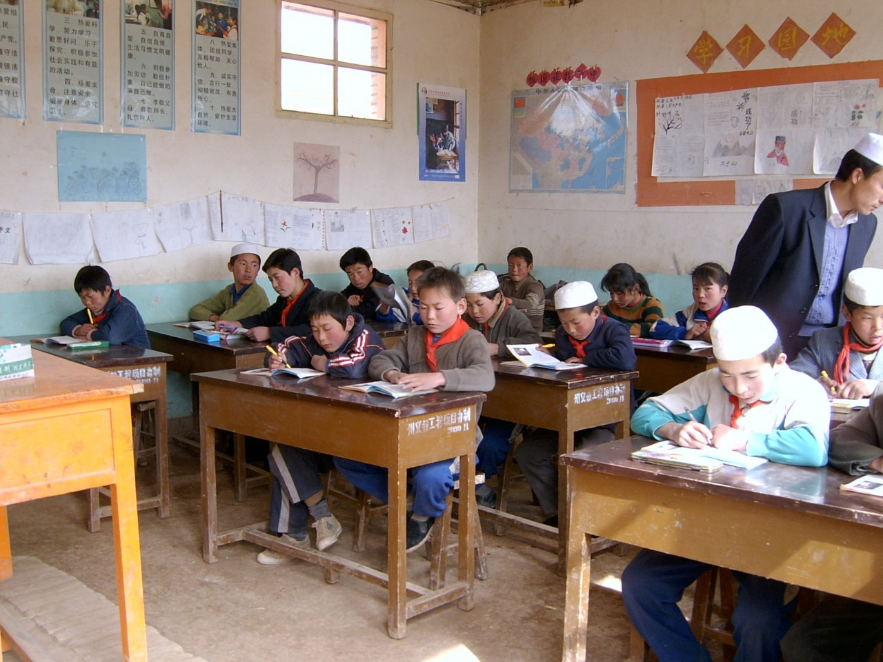 Fifth graders attending class in Daping village's only school. [Only a dozen or so of the students from this school in Gansu province have made it to high school. No one has ever gone to college. ] TSCHANG CHI-CHU