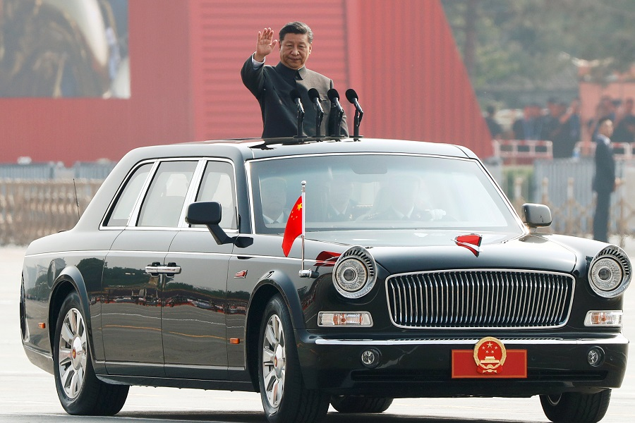 Chinese President Xi Jinping waves as he reviews the troops at a military parade marking the70thanniversaryof the People's Republic ofChina. (Thomas Peter/Reuters)