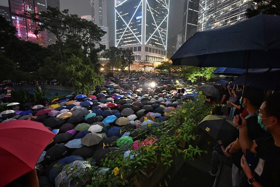 Chater Garden, in the heart of Hong Kong's business district, and its surrounding areas were turned into a sea of umbrellas, on 2 August 2019, as 13,000 civil servants gathered despite an evening shower to show their support for the anti-extradition movement. (SPH)