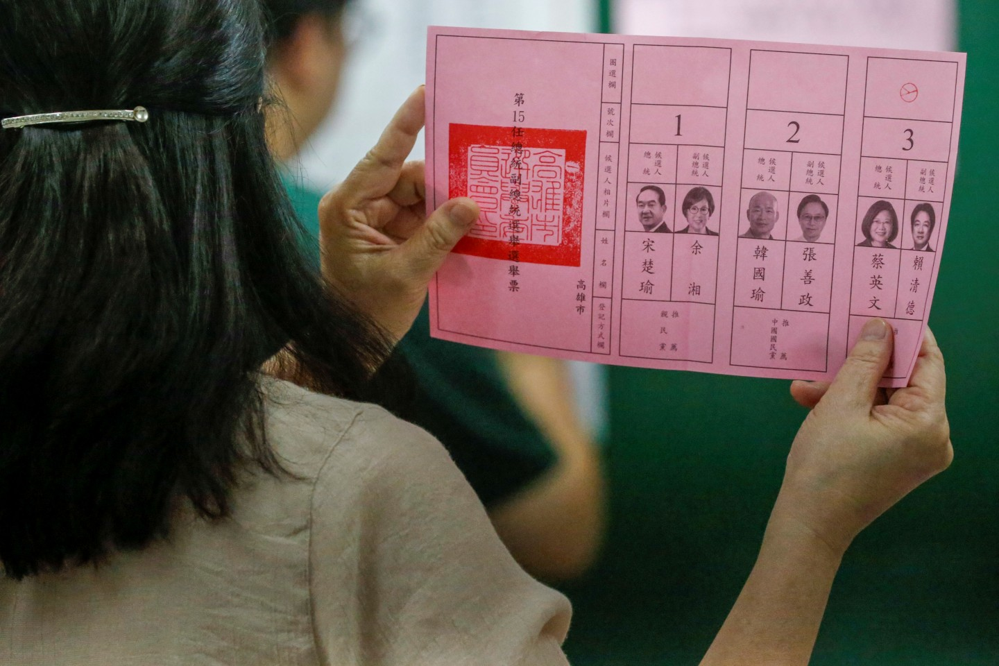 """Various state media have accused Tsai of resorting to """"dirty tactics"""" to get votes. In the picture, an election official shows a ballot with vote for Taiwan President Tsai Ing-wen as votes are counted at a polling station in Kaohsiung on 11 January 2020. (Ann Wang/Reuters)"""