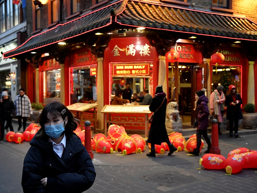 A woman wears a mask in London's Chinatown district, 24 January 2020. (Toby Melville/Reuters)