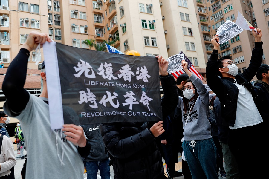 Residents wear face masks as they march to protest against the government's plan to set up a quarantine site close to their community amid the Covid-19 coronavirus outbreak, in Hong Kong, on 2 February 2020. (Tyrone Siu/Reuters)