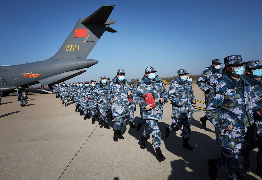 Medical personnel arrive in transport aircraft of the Chinese People's Liberation Army (PLA) Air Force at the Wuhan Tianhe International Airport following the outbreak of the Covid-19 coronavirus in Wuhan, Hubei province, China, on 17 February 2020. (China Daily via Reuters)