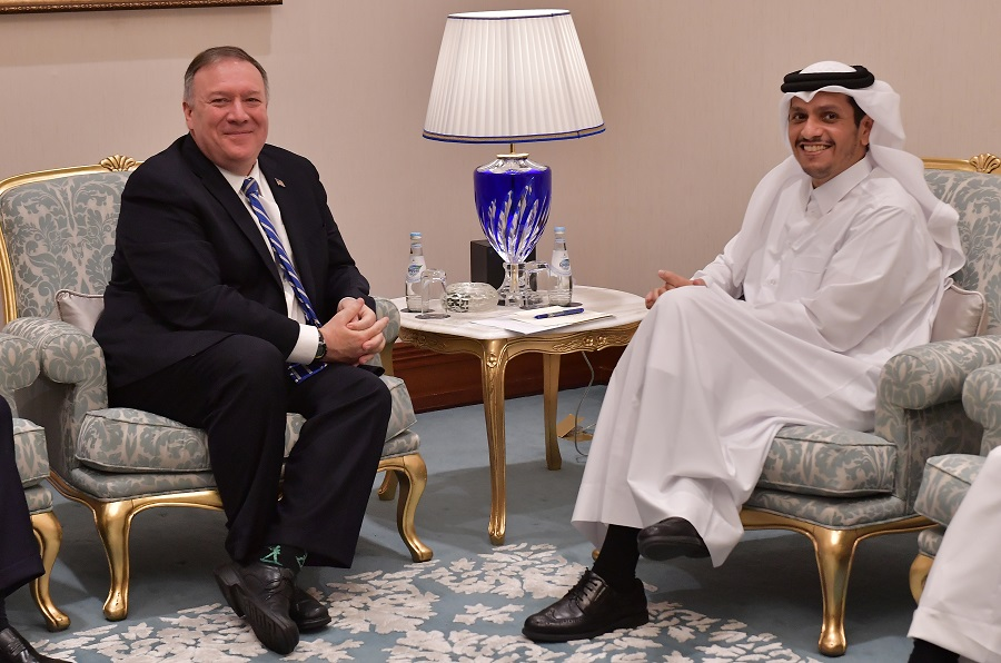 Qatari Deputy Prime Minister and Minister of Foreign Affairs Sheikh Mohammed bin Abdulrahman al-Thani meets with US Secretary of State Mike Pompeo on the sidelines of the peace signing ceremony between the United States and Afghanistan's Taliban in Doha, Qatar, on 29 February 2020. (Giuseppe Cacace/Pool via Reuters)