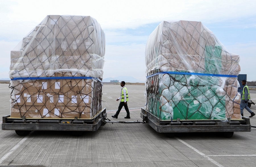 Ethiopian Airlines workers unload a consignment of medical donation from Chinese billionaire Jack Ma and Alibaba Foundation to Africa for Covid-19 testing, upon arrival at the Bole International Airport in Addis Ababa, Ethiopia, on 22 March 2020. (Tiksa Negeri/Reuters)