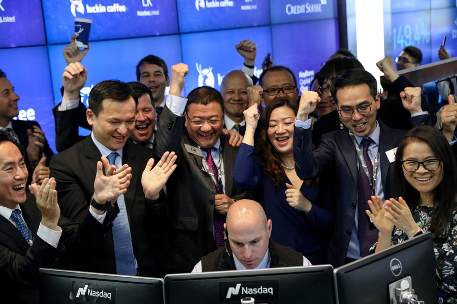 Jenny Qian Zhiya CEO of Luckin Coffee, and Charles Zhengyao Lu, non-executive chairman of Luckin Coffee, celebrate the first trade of the company's stock during the IPO at the Nasdaq Market site in New York, U.S., May 17, 2019. REUTERS/Brendan McDermid/File Photo