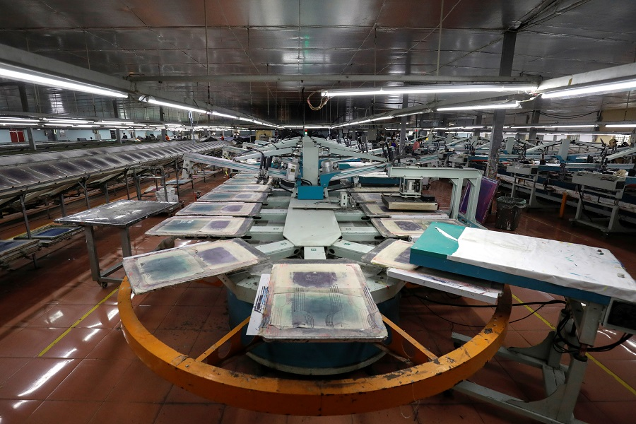 An empty printing assembly is seen at a partially closed industrial printing factory during the Covid-19 outbreak in Hung Yen province, Vietnam, on 7 April 2020. (Kham/Reuters)