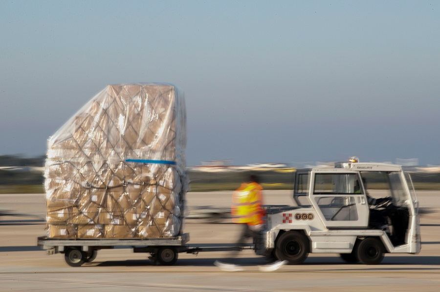 A shipment containing supplies of personal protective equipment is unloaded at Bari airport after arriving from Guangzhou, China, to help the southern Italian region of Puglia combat the spread of Covid-19, on 7 April 2020. (Alessandro Garofalo/Reuters)