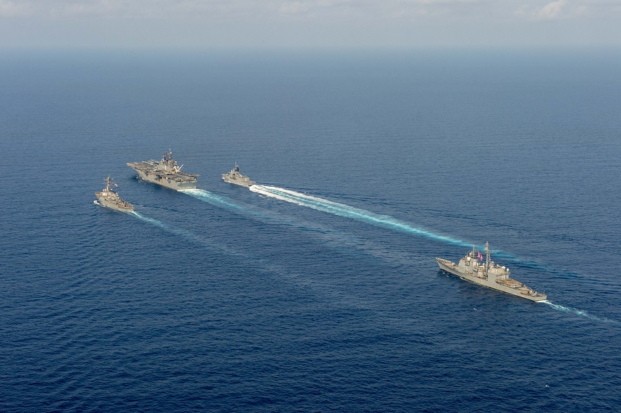 (left to right) Royal Australian Navy helicopter frigate HMAS Parramatta (top right) conducts officer of the watch manoeuvres with amphibious assault ship USS America (top middle), guided-missile destroyer USS Barry (top left) and guided-missile cruiser USS Bunker Hill (right) in the South China Sea, as pictured in this photo taken on 18 April 2020. (Australia Department Of Defence/Handout via Reuters)