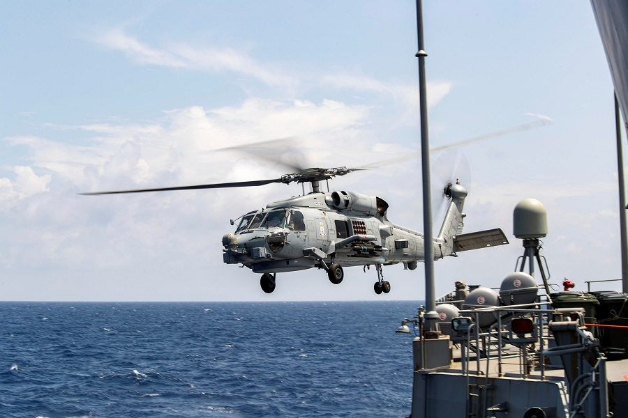 A Royal Australian Navy MH-60R Seahawk helicopter takes off from HMAS Parramatta during a South China Sea transit, in this 14 April 2020 handout photo. (Australia Department Of Defence/Handout via Reuters)