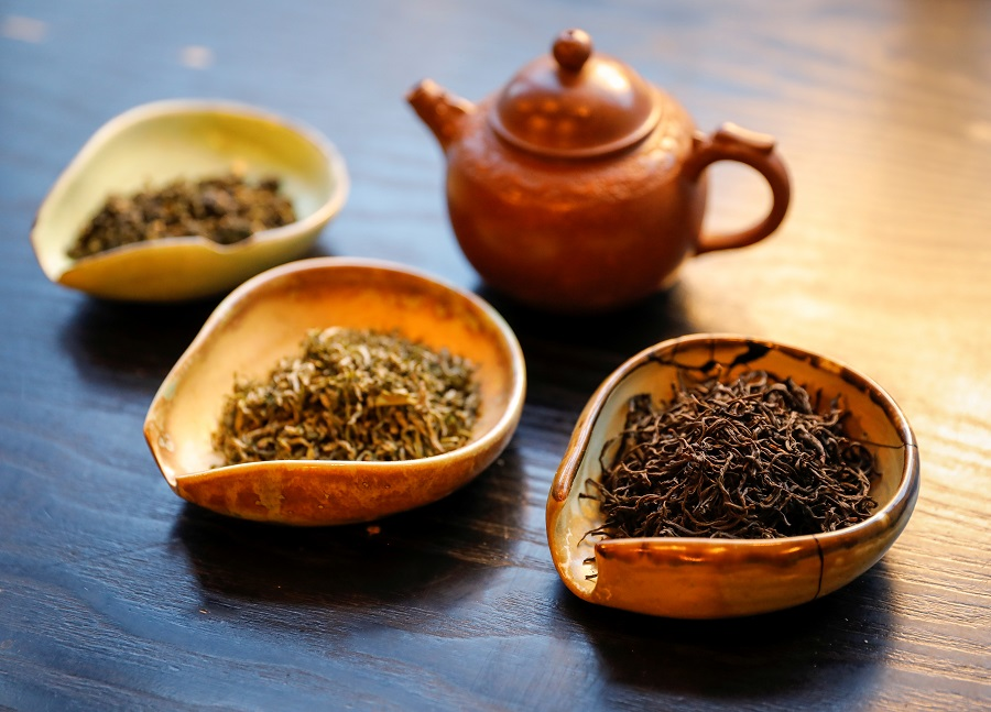 A view shows a pot and utensils with various types of tea leaves in a tea house in this picture illustration taken on 25 April 2020. (Shamil Zhumatov/Illustration/Reuters)