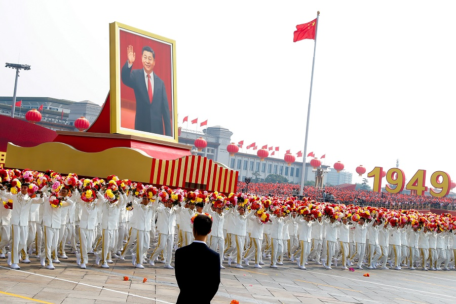 A float carrying a portrait of Chinese President Xi Jinping moves through Tiananmen Square during the parade marking the 70th founding anniversary of People's Republic of China, in Beijing, China, on 1 October 2019. (Thomas Peter/File Photo/Reuters)
